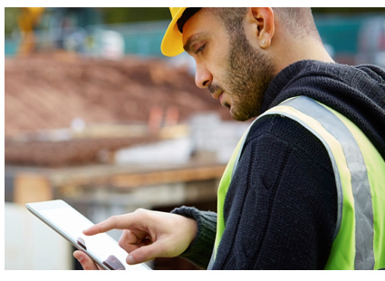 IFS field service apps construction worker using tablet