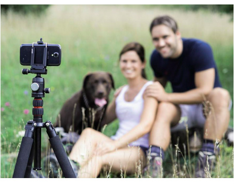 family posing with phone tripod